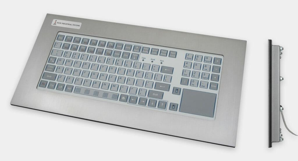 Tastiera industriale per montaggio a pannello con resistenti tasti a corsa breve e touchpad, veduta anteriore e laterale