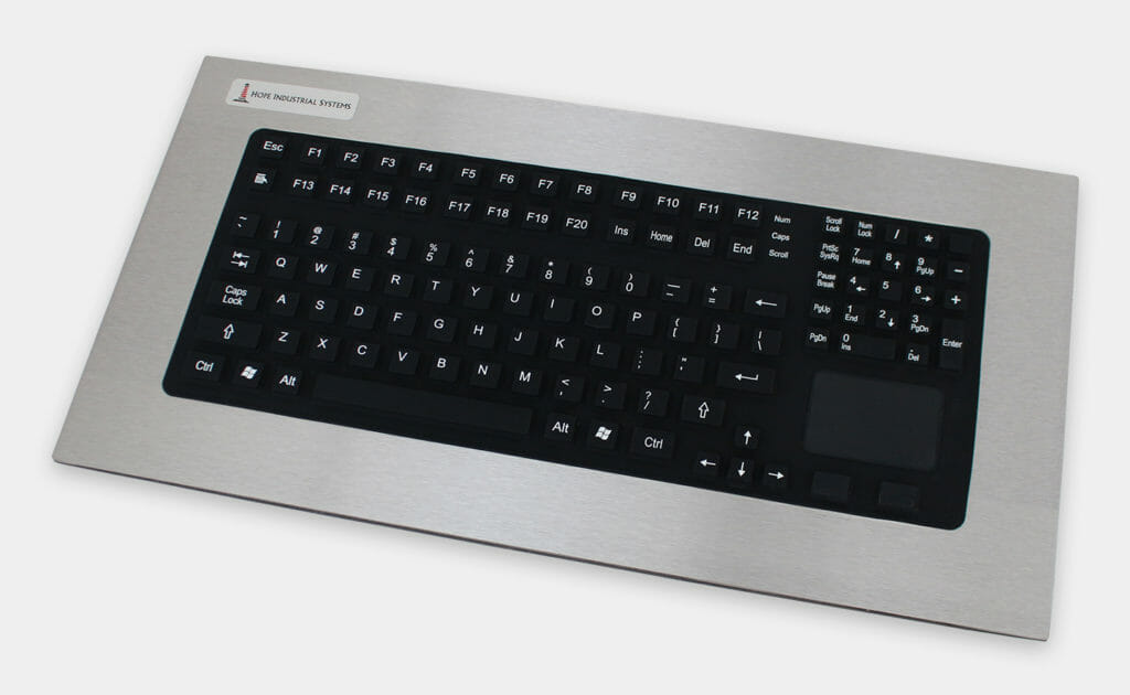 Tastiera industriale per montaggio a pannello con tasti resistenti a corsa lunga e touchpad